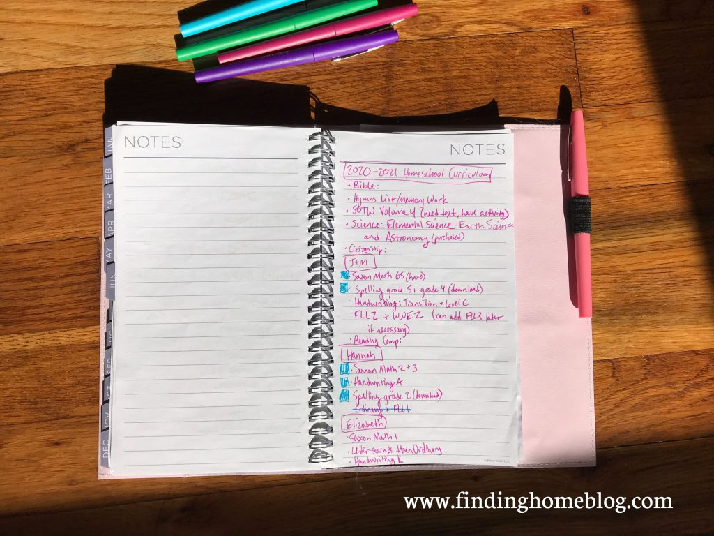 A list of homeschool subjects and curriculum choices on the right side of a planner page. Several pens nearby