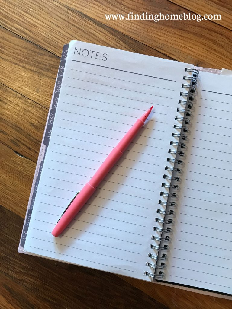 An empty planner notes page, with an open pen on top