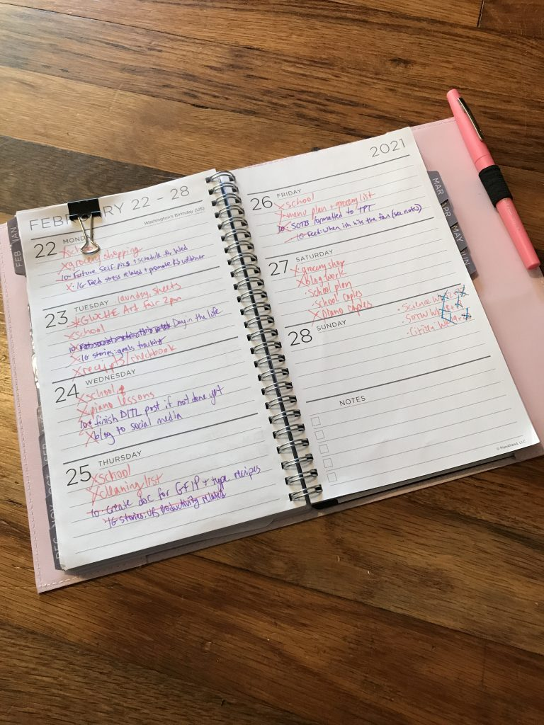 Picture of a planner filled out with various activities.